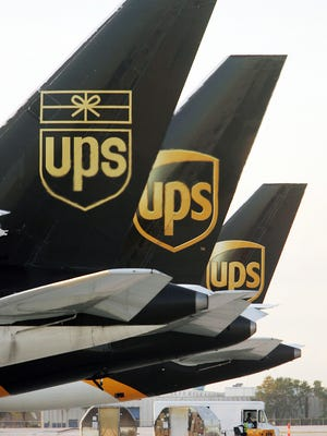 United Parcel Service (UPS) cargo planes are lined up in Miami in 2006.