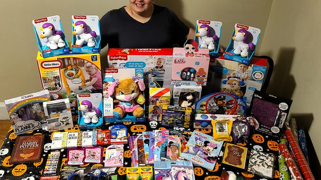 Taunton resident and Bristol-Plymouth student Alexis Pacheco is surrounded by many toys she collected through a donation throughout the city. Pacheco will be collecting through the month of December.