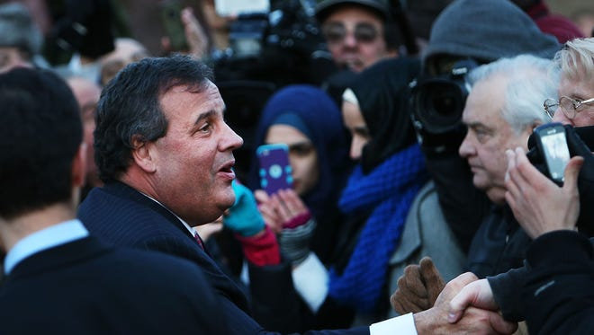 New Jersey Gov. Chris Christie shakes hands with residents in Fort Lee where he apologized to Mayor Mayor Mark Sokolich on Jan. 9, 2014, for a traffic jam. orchestrated by his aides.
