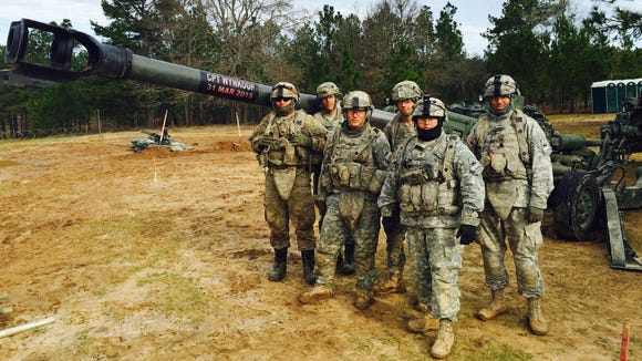 Members of 2nd Platoon, Bravo Battery, 2nd Battalion, 3rd Field Artillery Regiment show off a M777 howitzer that is dedicated to their fallen comrade, Capt. Jonathan Wynkoop, who died during a training accident at Iron Focus in March 2015.