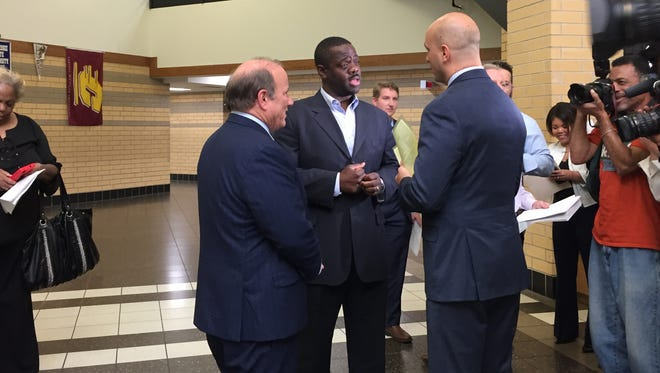 Mayor Mike Duggan, Councilman Andre Spivey and School Superintendent Nikolai Vitti  chat Thursday about recreation centers
