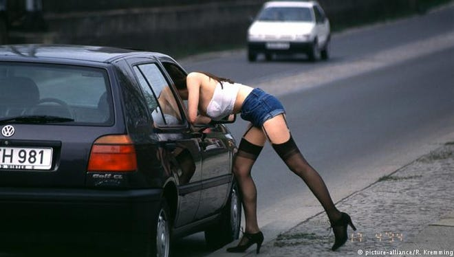 A Berlin street prostitute solicits a client in Kürfürstenstraße.