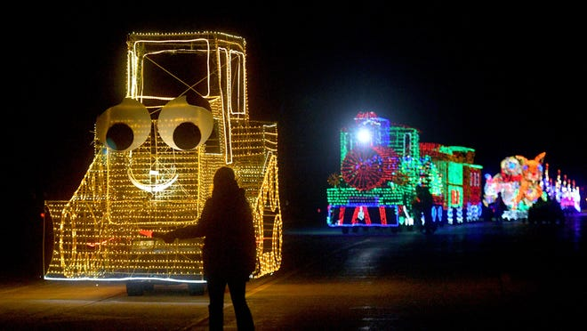 An East Peoria Festival of Lights volunteer guides a Terry the Tractor float during a recent annual Parade of Lights in East Peoria.