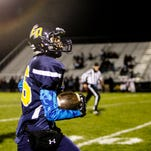 Lansing Eastern's Matt Nguyen runs in for a touchdown against Sexton Friday, October 21, 2016 at Sexton.  Nguyen was diagnosed with a cancerous brain tumor last December and is now cancer free.  The senior was able to suit up for the final game of the season, and scored Eastern's only touchdown on a pass play late in the fourth quarter.  Sexton won 39-6.