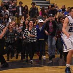The Carson student section storms the court after defeating Galena in overtime in Sparks on Feb. 19, 2016.