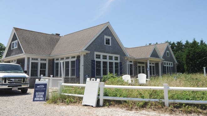 Chapin's Bayside on Tuesday withdrew its application to host outdoor entertainment, but the owner plans to come back before the Board of Selectmen for a license at a later date.