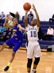 Thurston's Bryanna Burton (15) goes up for the shot