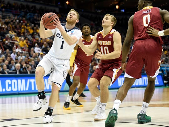Butler guard Tyler Lewis (1) drives to the basket while defended by Winthrop Eagles guard Anders Broman (10) during the second half of the game in the first round of the NCAA Tournament at BMO Harris Bradley Center.