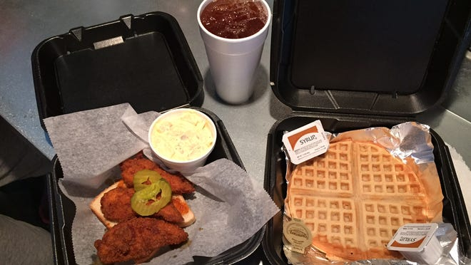 Medium-spiced chicken tenders with waffle and potato salad, served with fruit tea