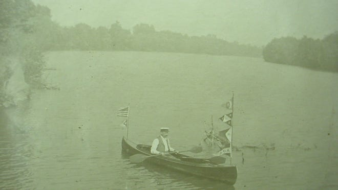 Newspaper editor Tacitus Hussey led an armada of flag-carrying canoes on the Des Moines River in 1896.