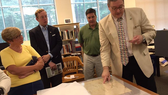 "Dr. Jude Pfister, Morristown National Historical Park's Chief of Cultural Resources, shows the original blueprints for Washington Headquarters Museum during the ""The Civilian Conservation Corps and the Creation of Morristown National Historical Park"" tour."