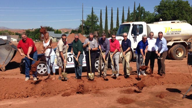 Washington City officials, Washington City Police Department officers and chamber of commerce members break ground Thursday for the organization's new building at 111 N. 100 East, Washington City.