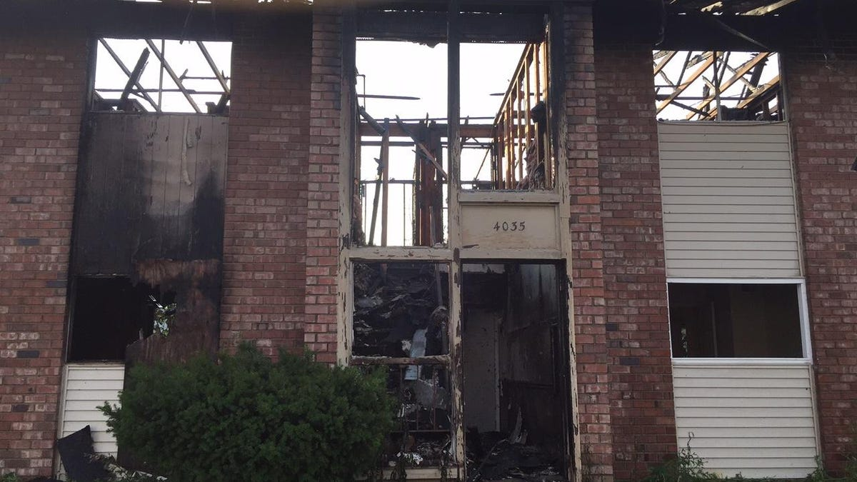 Firefighters put out an early morning blaze in one of the buildings at the abandoned Oak Tree Apartments in the 4200 block of Post Road on Friday morning.