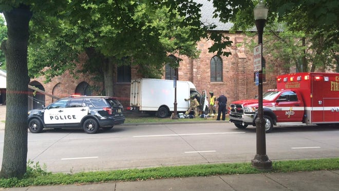 Emergency crews work at the scene Thursday where a van hit the Universalist Unitarian Church in downtown Wausau.