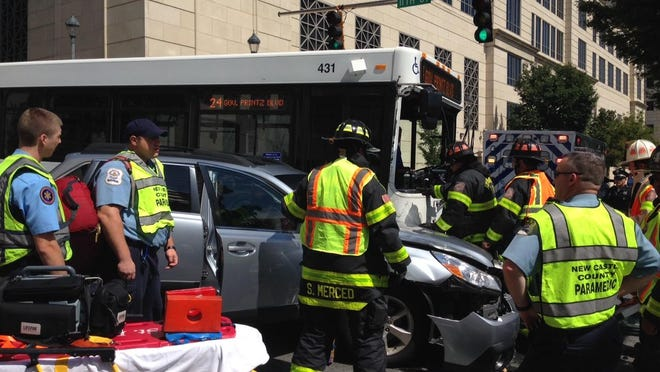 Emergency crews were on the scene of a crash involving a bus and another vehicle at 11th and Walnut streets in Wilmington Wednesday morning.