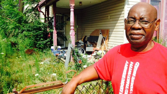 Willie Thomas says the abandoned house next door to his is crawling with snakes, groundhogs and mice.