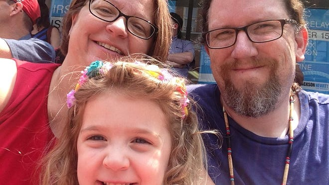 Cindi Andrews with husband Jeffery Wissman and daughter Katie, 4, at the Northside Fourth of July Parade last month. The family was prepared to camp out this fall to get Katie in their chosen Cincinnati school.