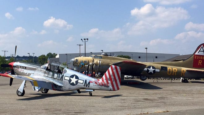 A P-51 Mustang and B-17 Bomber were among the World War II planes at the Morristown Airport.