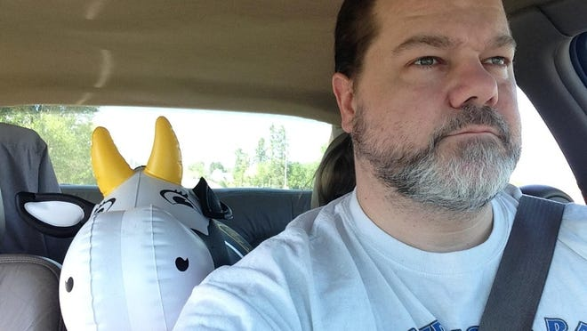 John Mitchell, a film producer from California, originally from Cameron, Wis., filmed the majority of the documentary on his own, with his only steady companion being Lexxy, an inflatable cow.