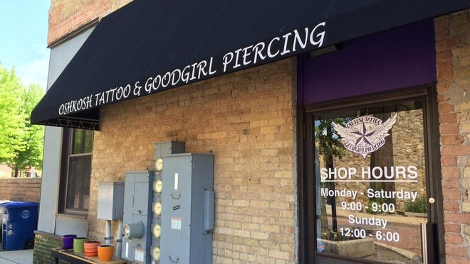 Oshkosh Tattoo and Good Girl Piercing moves into a new storefront at 233 High Ave. Tuesday.