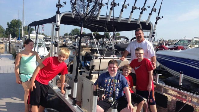 From left, Emma Dupuie, John Zinz, Ethan Dupuie, Colin Hickey, Connor Hickey and Brad Dupuie prepare for some fishing on an Angler Qwest pontoon. The Qwest pontoon has features specially designed for fishing.