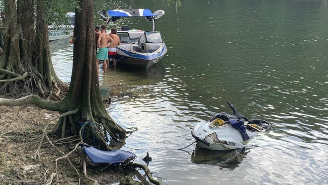 A jet ski is shown in the Santa Fe River after it was recovered following a May 30 crash with a boat that sent four people to the hospital.