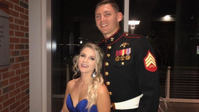"This photo provided by his family shows Sgt. Wolfgang ""Wolf"" K. Weninger with his girlfriend, Shannon Riggins, at the Marine Corps ball in 2019 near Camp Lejeune in North Carolina. On Friday, June 19, 2020, Weninger, 28, was set to graduate from the U.S. Army Airborne School at Ft. Benning, Ga., where he went to learn how to become a paratrooper. On Tuesday, June 16, he was killed during a training jump."