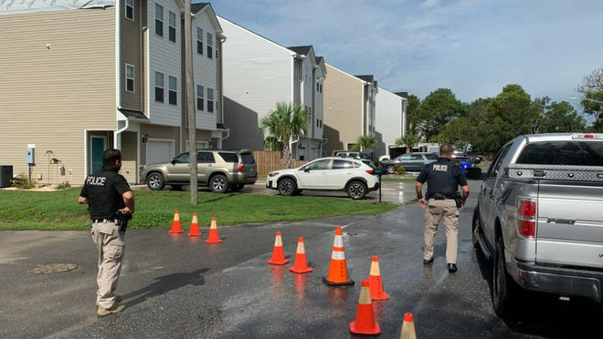 Carolina Beach police have blocked off access to an apartment where they say a man with a gun has barricaded himself inside.