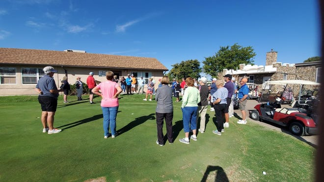 Participants Arkansas Valley Hospice Mac Jones & Billie Sue Pantle Inaugural Memorial Golf Tournament converge on the green at the Rocky Ford Golf Course in 2019.