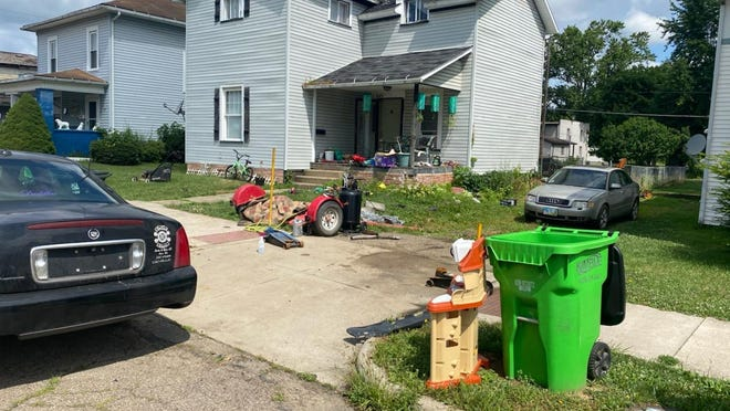 This Uhrichsville house was the subject of a property improvement notice from the city.