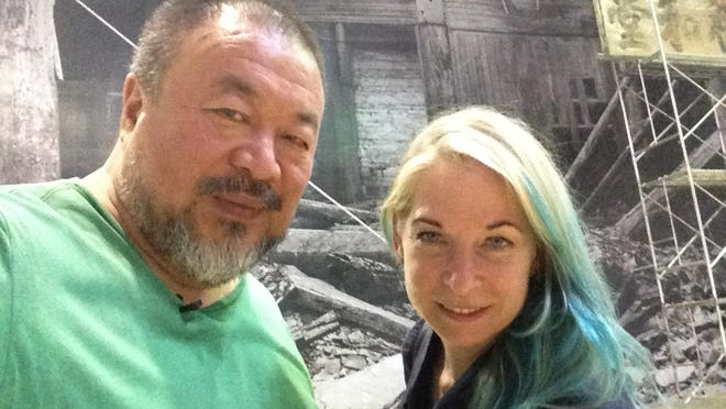 Ai Weiwei and director Cheryl Haines in Beijing.