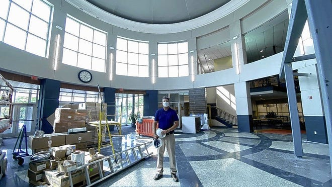 Mike Phillips, recreation and operations superintendent for Westerville Parks and Recreation, stands in the renovated front-desk area located in the center of the Westerville Community Center.