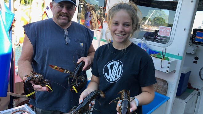 Ella Byrne and her father Ward are seen lobstering together on the FV Sugar Daddy.