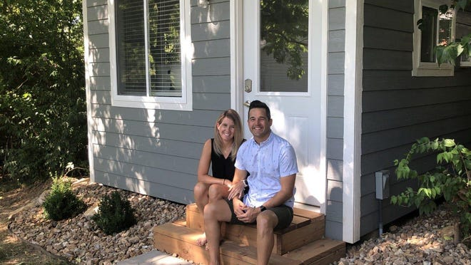 """Julie Masson's backyard """"she shed"""" looks like a mini home. Her husband, Jesse, helped build it during the pandemic so she can work remotely."""
