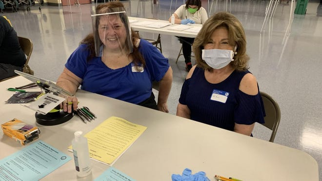 Nancy McEnanly, left, and Deb Ruisi were among the poll workers Tuesday at Toll Gate High School in Warwick.