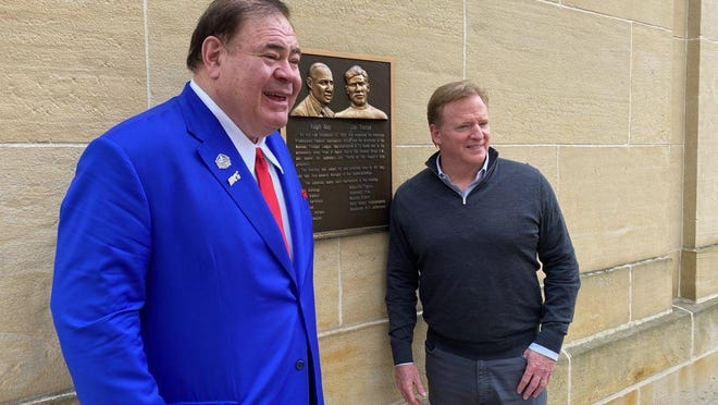 Pro Football Hall of Fame President David Baker and NFL Commissioner Roger Goodell pose for a photo at the plaque marking the site where the NFL was organized in Canton on Sept. 17, 1920.