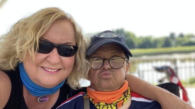 Marynia Page lost her job at the Rockingham County Register of Deeds after taking an unpaid leave to care for her brother-in-law, Larry, who has Down syndrome while his day center has been closed during the pandemic.