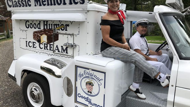Pete and Geri Riendeau are all smiles as they sit in their vintage Good Humor ice cream truck in South Sanford.