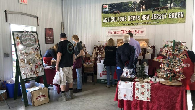 Visitors to the Farmers Market at the Sussex County Fairgrounds browse a section set up by organizers of the German Christmas Market Saturday, Sept. 26.