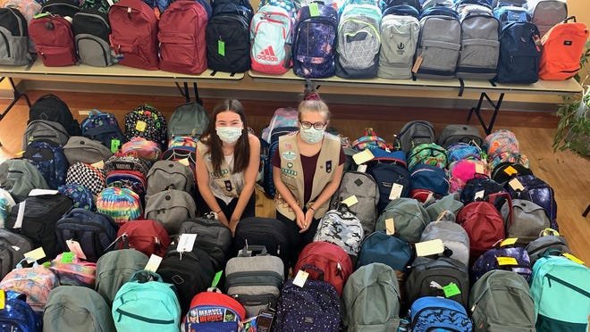 """Chloe Hall and Colleen Bartell partnered with End 68 Hours of Hunger, a local volunteer-based effort, on their """"Project Backpack,"""" which earned the girls the Girl Scout Silver Award - the highest honor cadettes can achieve."""
