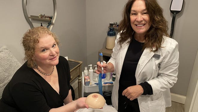 Heidi Conlin, right, provides 3D areola tattoos for free out of her treatment room at Bliss 360 Salon and Day Spa on Route 1 in Hampton, including client and cancer survivor Stacey Lynn of Somersworth.