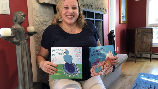 """Local author Jocelyn Lacey is working toward publishing her third children's book, """"What Do Police Officers Do?"""" She is seen here at her Kennebunkport home with her two earlier books on Wednesday."""