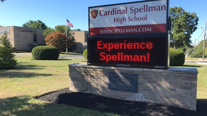The sign outside Cardinal Spellman High School on Court Street in Brockton, Saturday, Sept. 19, 2020. Three students at the school have tested positive for COVID-19 after an off-campus group dinner, school officials said.