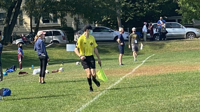 Soccere referees, shown here working at a game in Belmont, will have a different role with pandemic restrictions changing the rules of the game this fall.