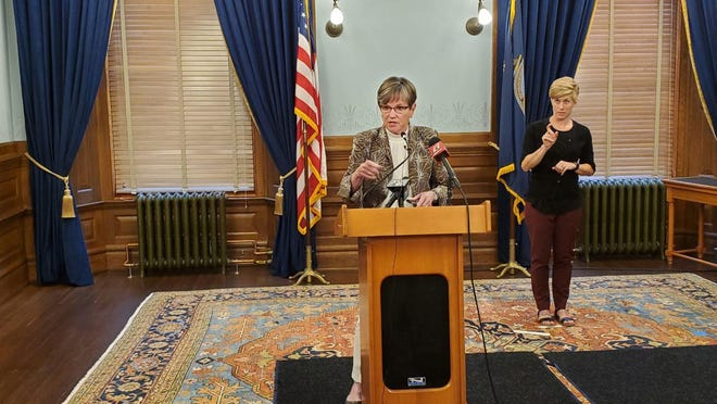 Gov. Laura Kelly speaks to the media Monday at a Statehouse news conference.