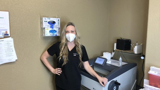 Dr. Kristina Collins stands next to a cryostat in the back room of the Austin Skin dermatology practice in Smithville.