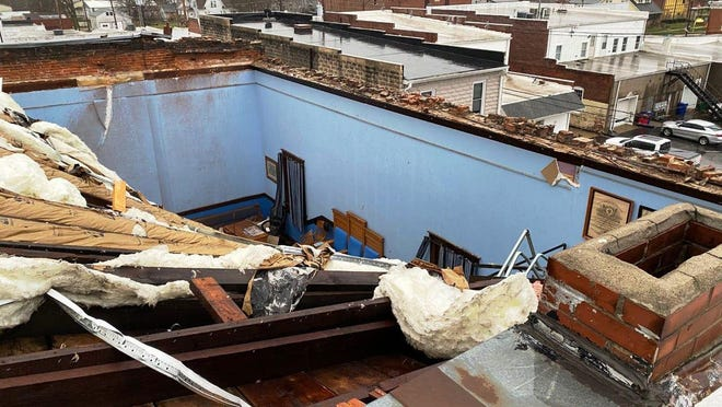 The storm that passed through the Peoria area Tuesday peeled back the roof of a building in Elmwood.