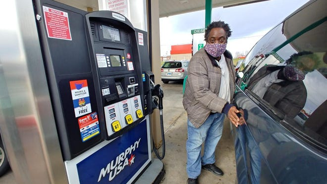 Al Feaster of Rockford fills up Monday at the Murphy USA gas station at West Riverside Boulevard and Owen Center Road in Rockford.