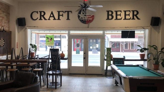 The front entryway of Bastrop Beer Company in Bastrop includes an area to play darts and a pool table as well as an station where hand sanitizer is available.