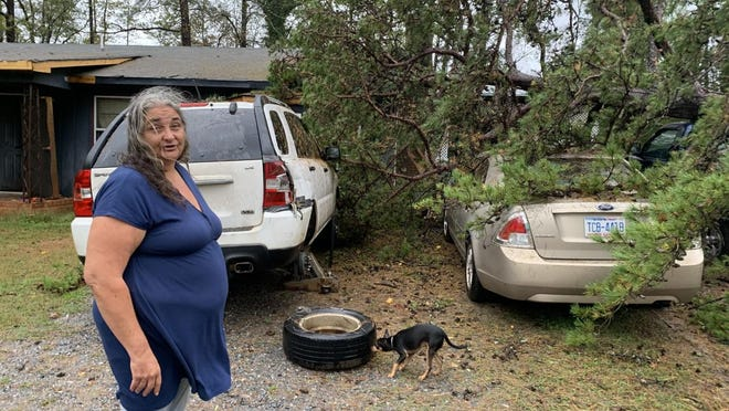 Debra Austin recounts hearing the tree coming down and almost crashing through her roof. If her husband's truck hadn't stopped the tree, it might have crashed into the room she was in.